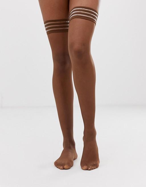 Nubian Skin nude matte 10 denier hold ups in dark