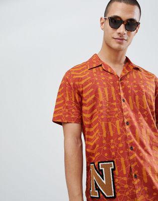 Nudie Jeans Co – Brandon – Kurzärmliges Batikhemd aus Bio-Baumwolle in Orange