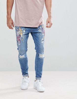 Облегающие джинсы с рваной отделкой, эффектом брызг краски и заниженным шаговым швом SikSilk
