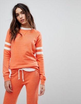 Ocean Drive – Sweatshirt i tvättad orange färg med ränder