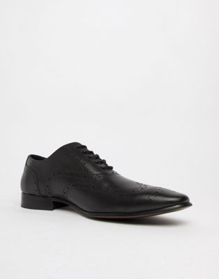 Office Glide brogues in black leather