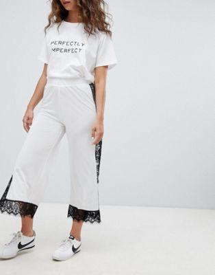 Imagen 1 de Pantalones con ribetes de encaje de ASOS DESIGN