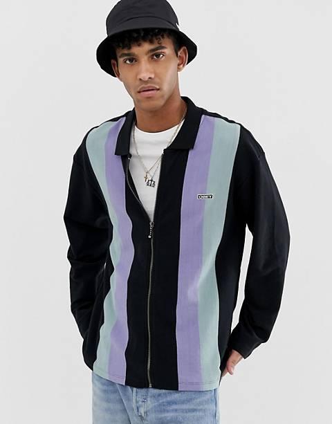 Polo de rayas con cremallera de algodón de comercio justo en negro Jinx de Obey