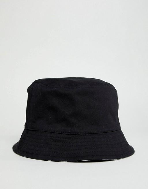 1be6cd356 Pretty Green x The Beatles reversible bucket hat in black