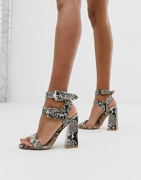 2649accf42 PrettyLittleThing heeled sandals with buckle and stud detail in snake