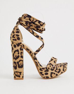 Image 1 sur Public Desire - Leonie - Sandales imprimé léopard à semelle plateforme avec lien à nouer à la cheville