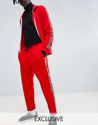 Pull&Bear Exclusive Tracksuit Bottoms In Red With Logo Side Stripe