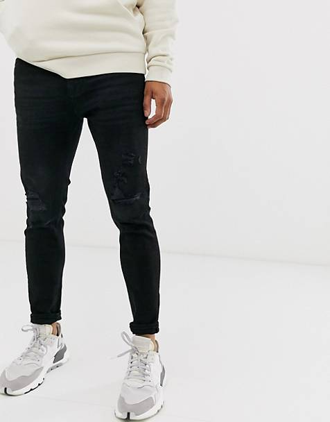 Pull&Bear tapered carrot fit jeans with knee rips in black