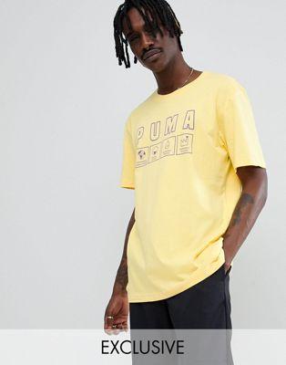 Puma – Gelbes T-Shirt aus Bio-Baumwolle mit Print, exklusiv bei ASOS