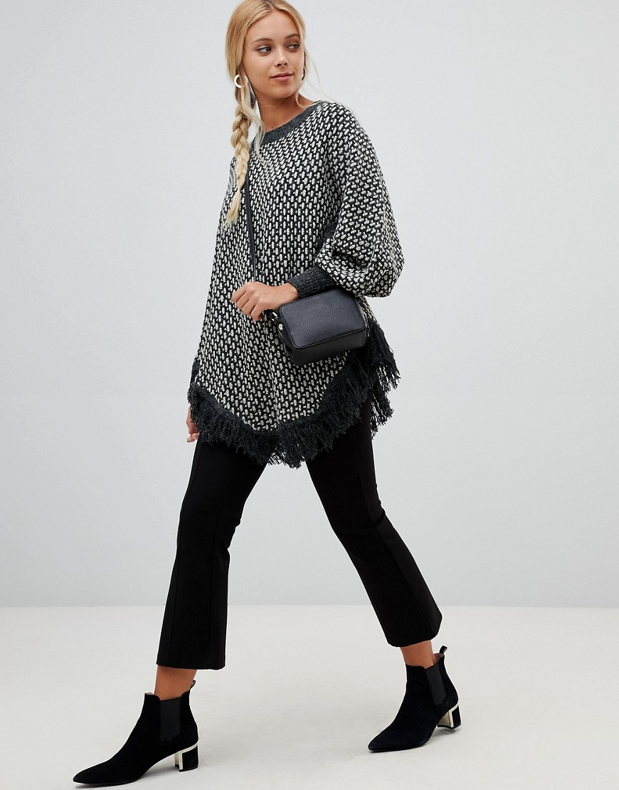 qed-london-roll-neck-poncho-jumper-with-tassle-detail by jumper