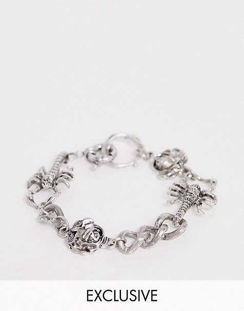 Reclaimed Vintage inspired mixed charm bracelet in silver exclusive to ASOS