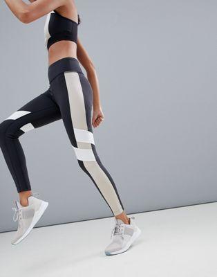 Reebok - Legging de sport color block - Noir et beige