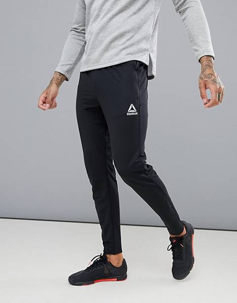 Reebok Training Work Out Ready Trackster Tapered Sweatpants In Black CW5031