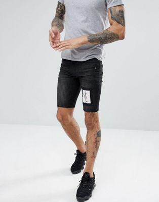 Religion Skinny Fit Denim Shorts In Black With Skeleton Patch