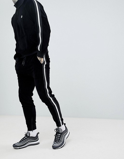 Image 1 of Religion skinny fit velour jogger in black with side taping