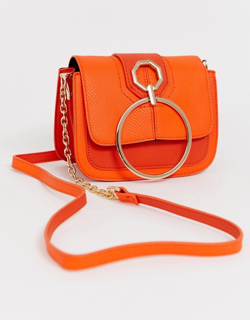 Image 1 of River Island cross body bag with circle detail in orange
