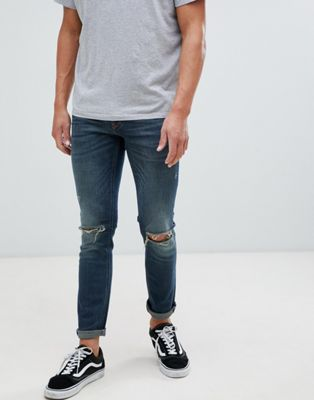 River Island skinny fit jeans with knee rips in mid wash blue
