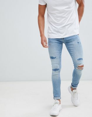 River Island super skinny jeans with rip and repair in light blue wash
