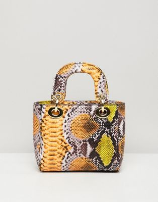 Image 1 of Sacred Hawk bag in mixed snake print