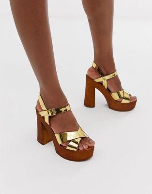 Imagen 1 de Sandalias de tacón doradas Translate de ASOS DESIGN