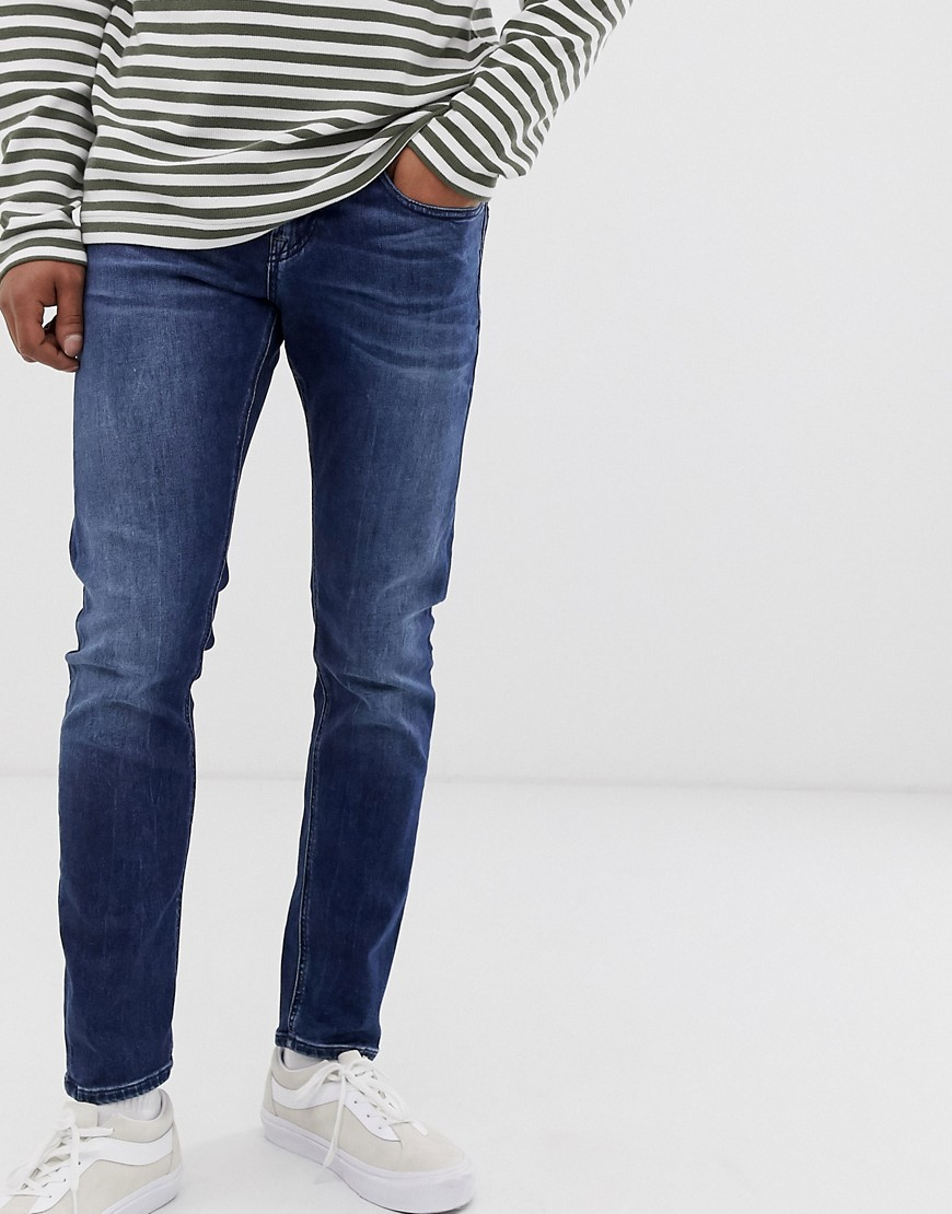 Scotch and Soda - blå vaskede smalle jeans med gulerodssnit