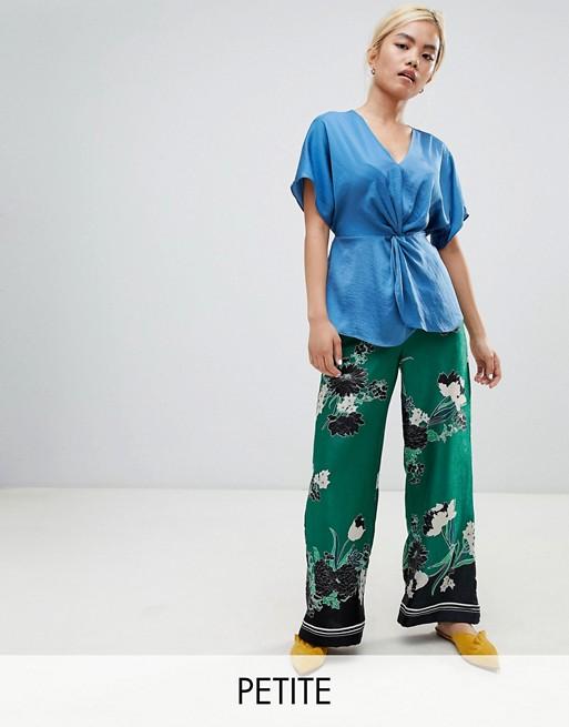 Изображение 1 из Широкие брюки с цветочным принтом River Island Petite