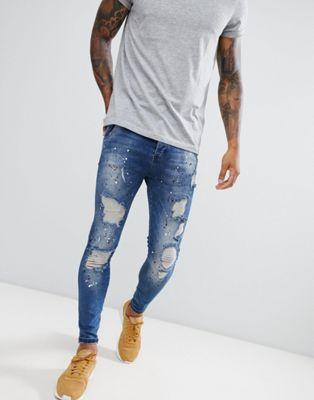 Bild 1 von SikSilk – Dunkelblaue, enge Jeans mit niedriger Taille und Farbspritzern