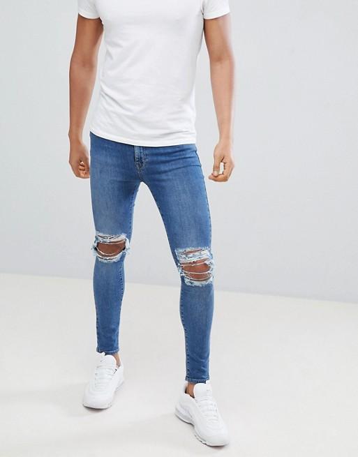 Синие рваные джинсы скинни Jaded London
