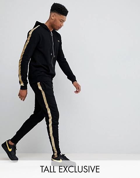 Sixth June skinny sweatpants in black with gold side stripe exclusive to ASOS