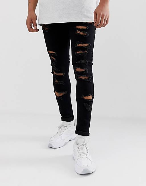 Sorte spray on-jeans i powerstretchmed kraftige flænser fra ASOS DESIGN