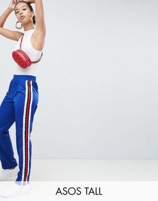 Спортивные штаны с полосками и заклепками сбоку ASOS DESIGN TALL