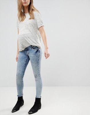Supermom - Jeans premaman skinny con fascia sopra il pancione regolabile effetto invecchiato