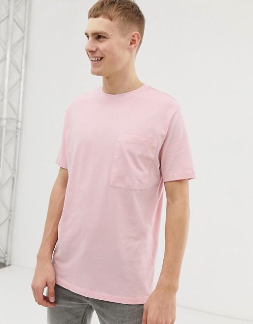 Изображение 1 из Свободная розовая футболка из органического хлопка с карманом ASOS DESIGN