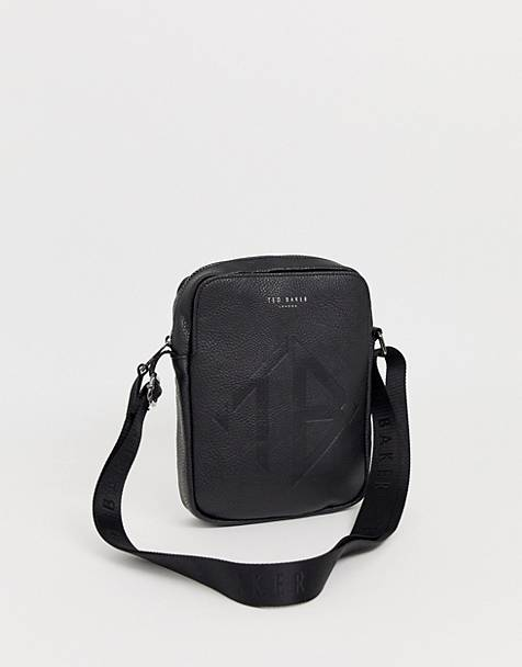Ted Baker Trama embossed logo flight bag in black