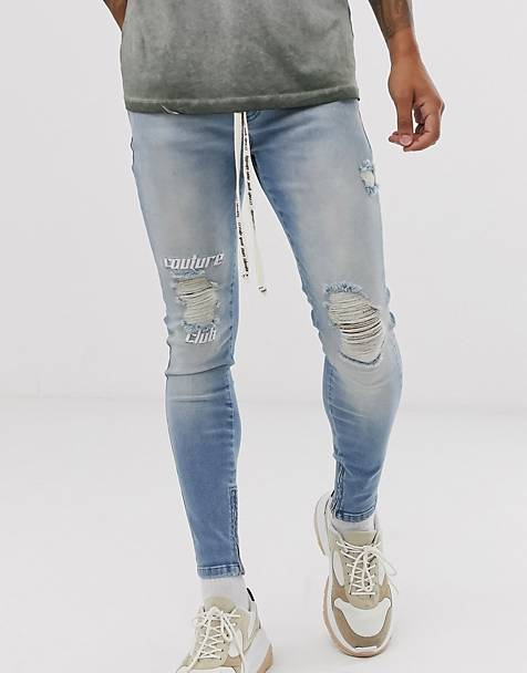 The Couture Club skinny jeans with knee logo and rips in mid wash blue