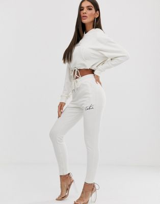 The Couture Club - Smaltoelopende joggingbroek in crème