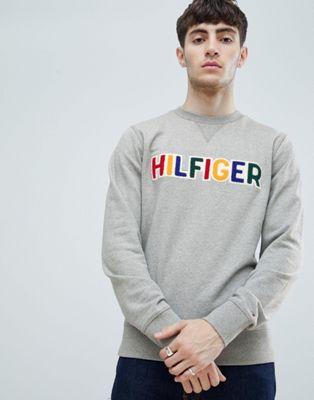 Tommy Hilfiger multi applique chest logo crew neck sweatshirt in grey marl