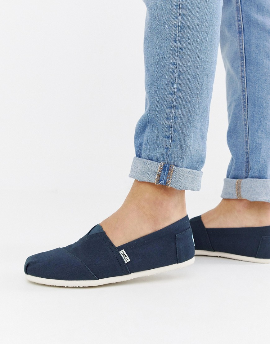 Espadrilles by Toms Canvas textile Part leather lining Slip-on design Elasticated insert Signature branding Flat sole with grip tread