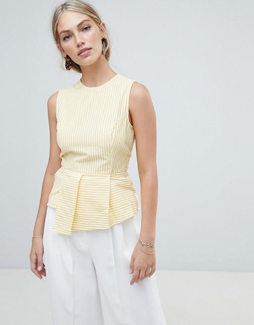 Warehouse – Ärmlös gul/vit randig blus med peplummidja