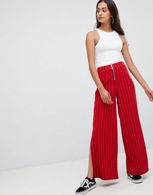 Wednesday's Girl - Pantaloni gessati a zampa con zip frontale