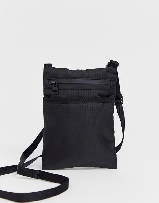 cc25eac997e60 Weekday Avalon passport bag in black | ASOS