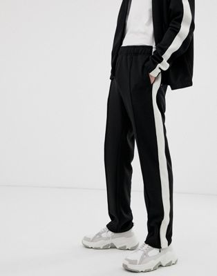 Weekday Local sweatpants in black with side stripe