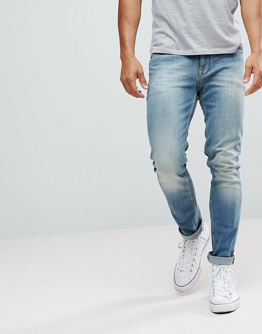Изображение 1 из Зауженные джинсы с потертостями ASOS