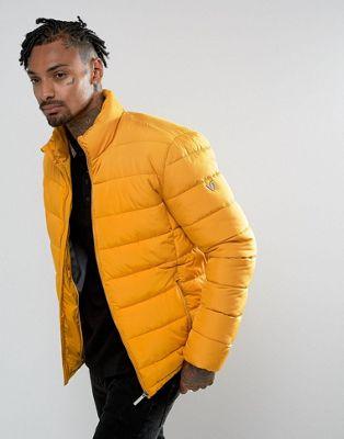Желтая дутая куртка Versace Jeans